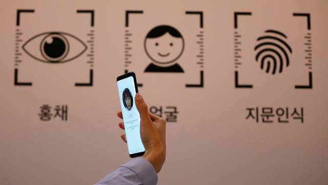 An employee demonstrates a Samsung Electronics' Galaxy S8 smartphone during a media event at a company's building in Seoul
