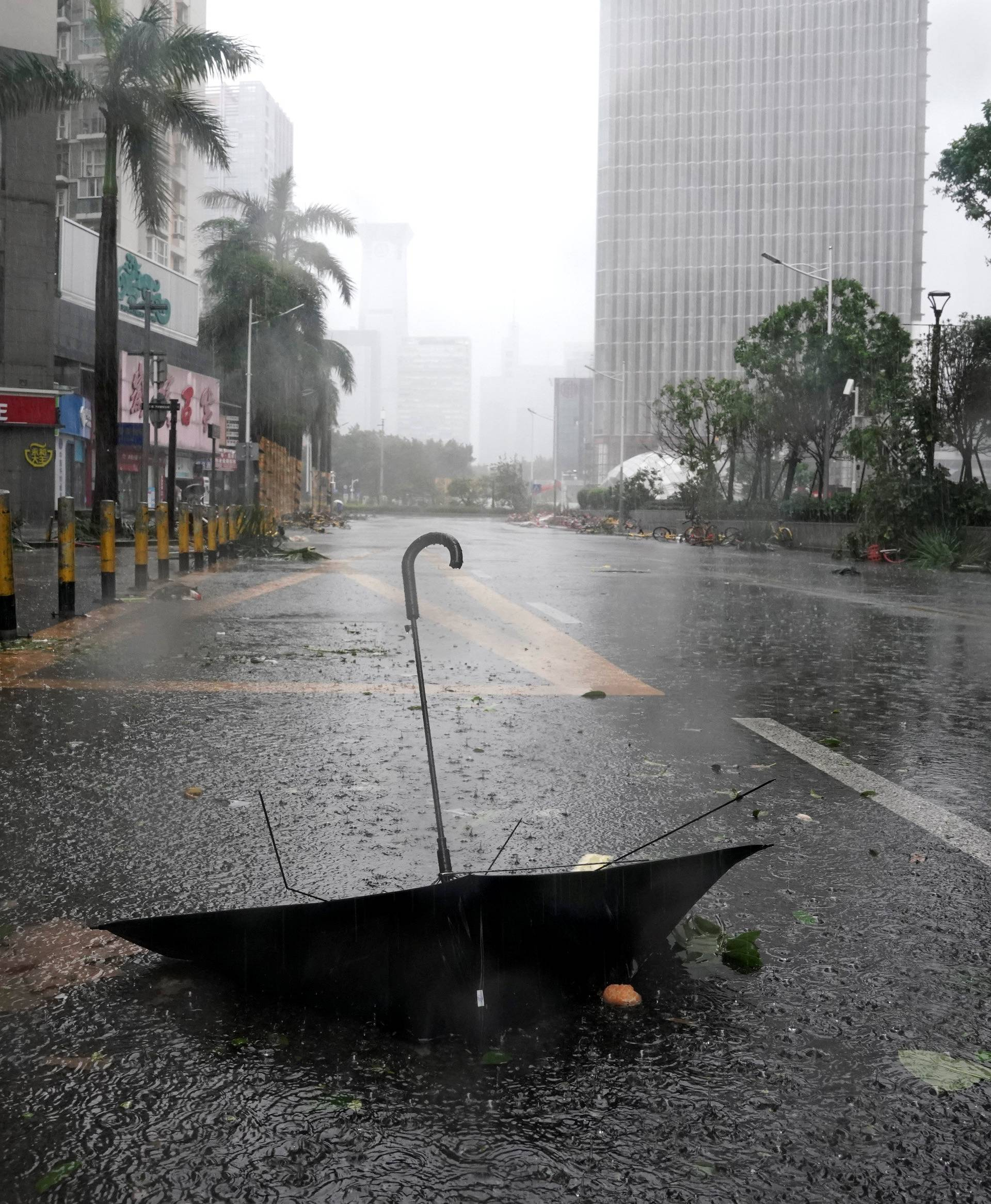 An umbrella is seen on a road after a rainstorm as Typhoon Mangkhut makes landfall in Guangdong province in Shenzhen