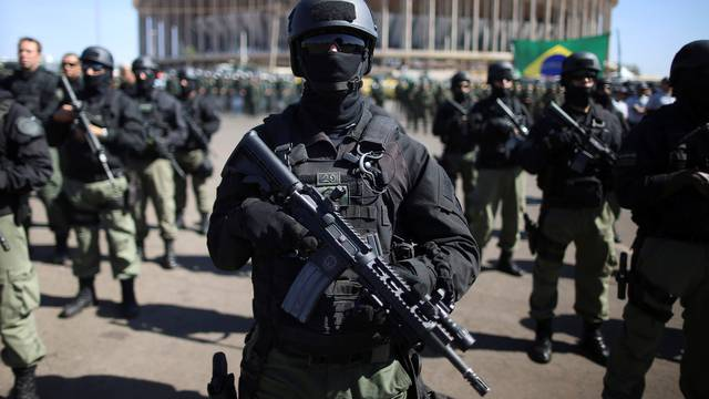 Brazilian police and special military forces stand outside the Mane Garrincha Stadium in Brasilia