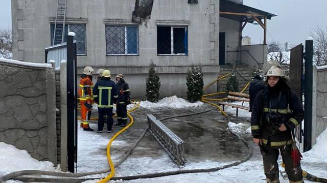 Rescuers work at the scene of the accident following a fire in nursing home in Kharkiv