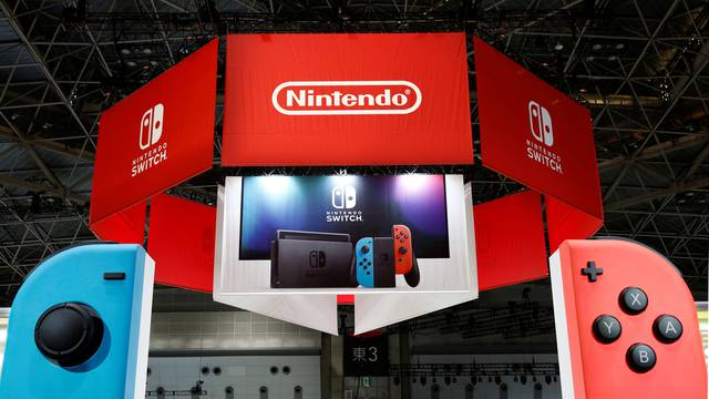 Banners of Nintendo's new game console Switch are pictured at its experience venue in Tokyo