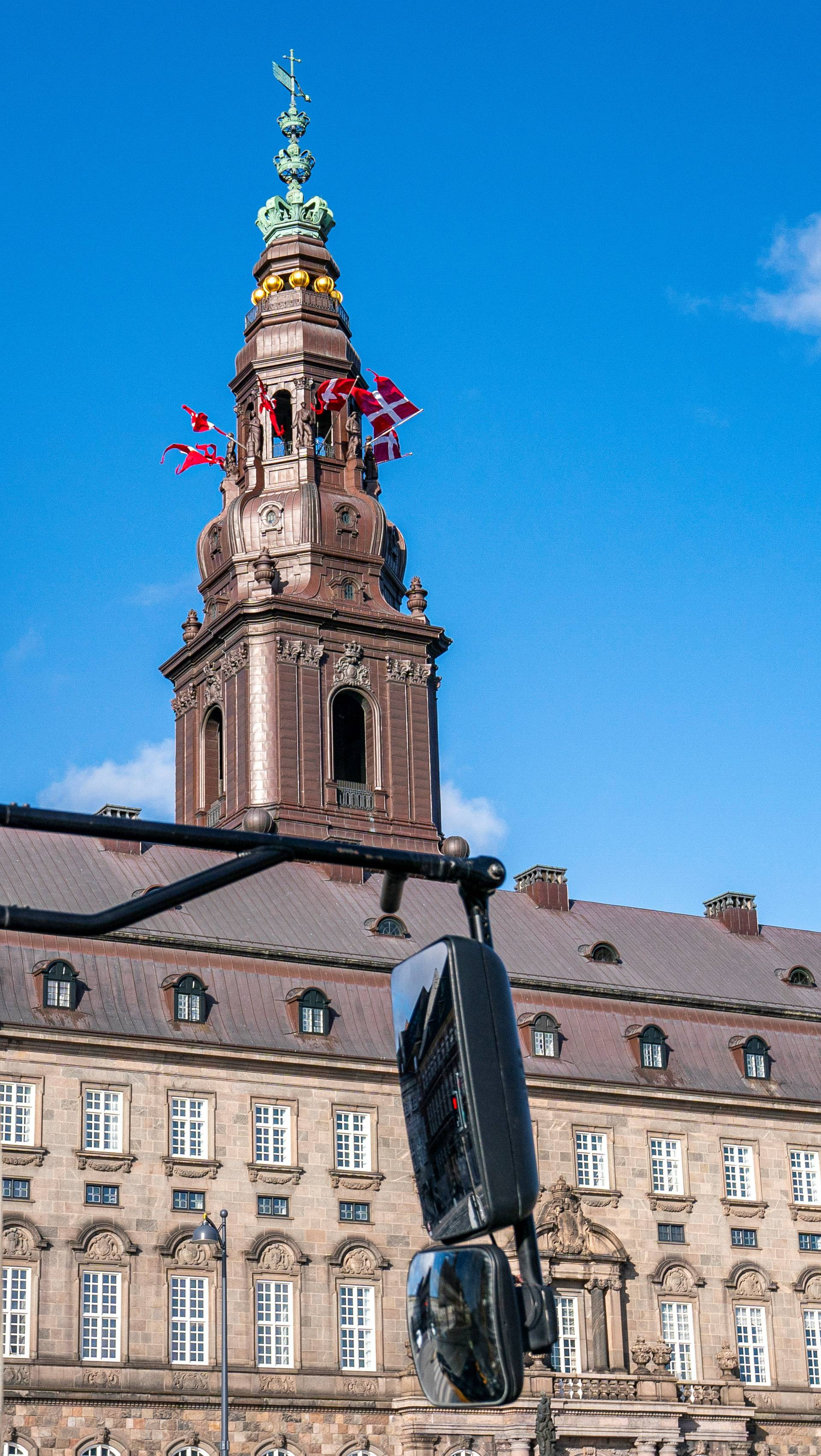 Flags flutter on the Christiansborg Palace People on the birthday of Danish Queen Margrethe, as the spread of the coronavirus disease (COVID-19) continues, in Copenhagen