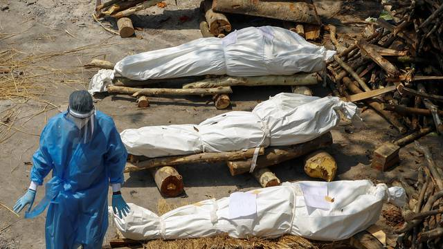 Mass cremation of coronavirus disease (COVID-19) victims at a crematorium in New Delhi