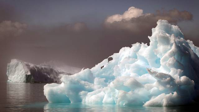 FILE PHOTO: Icebergs float in a fjord near the south Greenland town of Narsaq