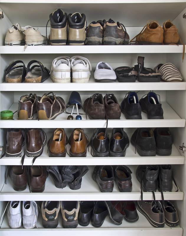 May shoes on shelves in a closet