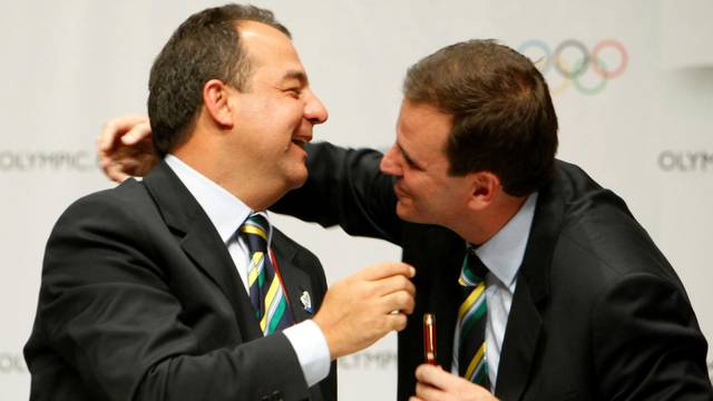 FILE PHOTO:  Brazil's Sergio Cabral, Governor of Rio de Janeiro, and Eduardo Paes, Rio de Janeiro city Mayor, celebrate after Rio was chosen to host the 2016 Olympic Games in Copenhagen