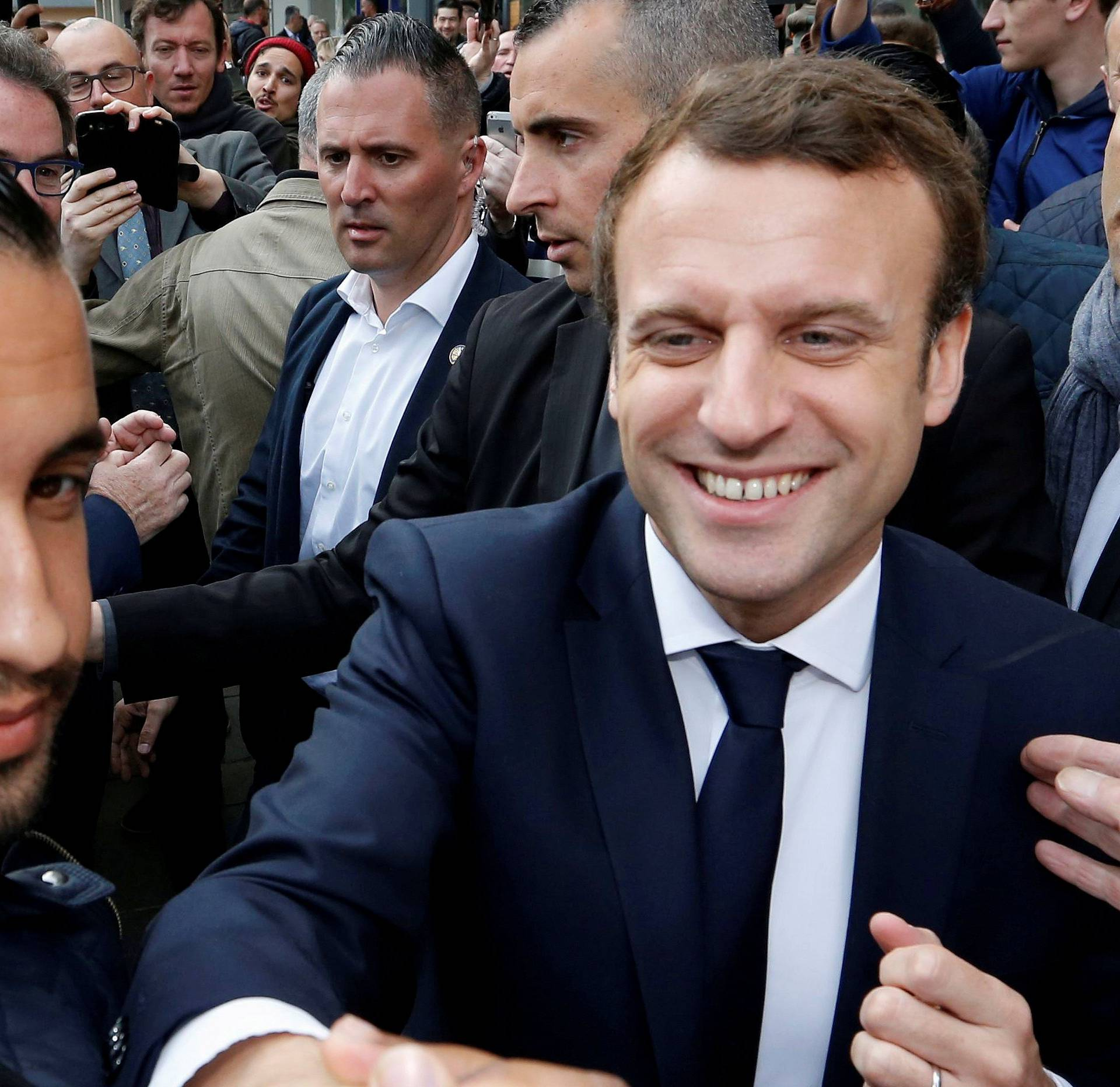 FILE PHOTO: Emmanuel Macron, head of the political movement En Marche !, or Onwards !, and candidate for the 2017 presidential election, flanked by Alexandre Benalla, head of security, attends a campaign visit in Rodez