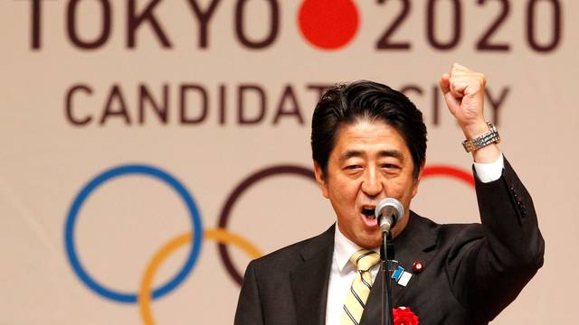 FILE PHOTO: Japan's Prime Minister Shinzo Abe gestures as he speaks during Tokyo 2020 kick off rally in Tokyo