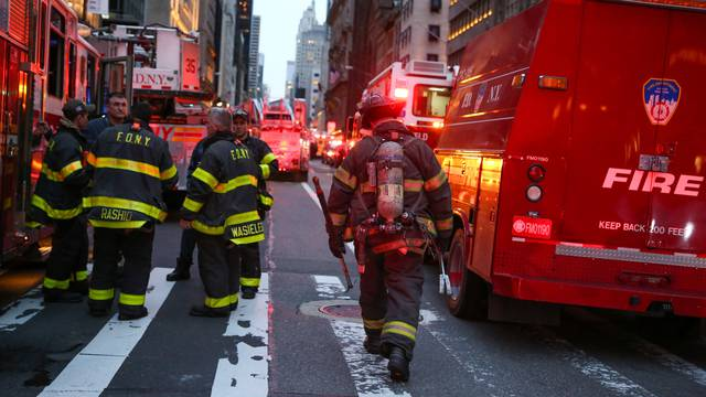 First responders work on a fire in a residential unit at Trump tower in the Manhattan borough of New York City