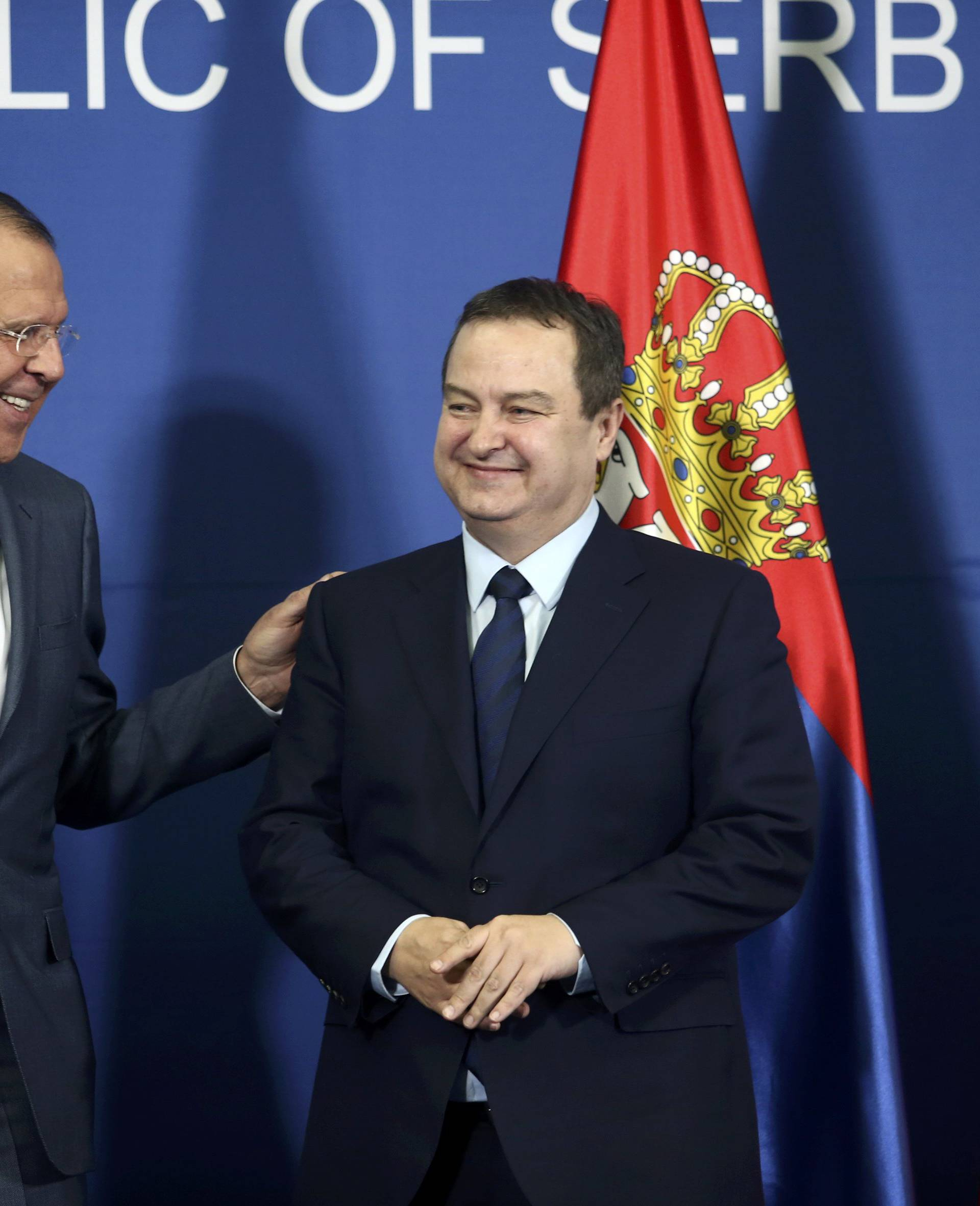 Serbian Foreign Minister Dacic and his Russian counterpart Lavrov arrive for a press conference in Belgrade