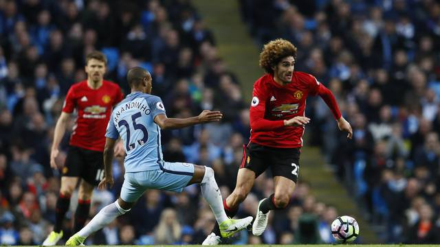 Manchester City's Fernandinho in action with Manchester United's Marouane Fellaini