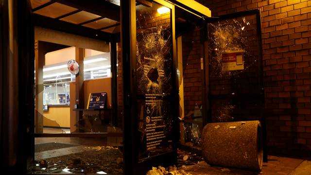 A vandalized Bank of America office is seen after a student protest turned violent at UC Berkeley during a demonstration over right-wing speaker Milo Yiannopoulos, who was forced to cancel his talk, in Berkeley, California