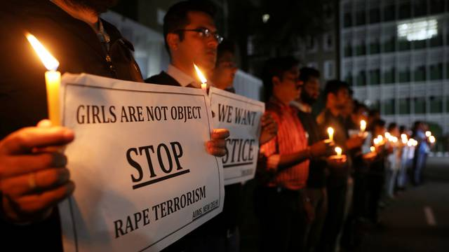 FILE PHOTO: Resident doctors and medical students from AIIMS attend a candle-lit march to protest against the alleged rape and murder of a 27-year-old woman on the outskirts of Hyderabad, in New Delhi