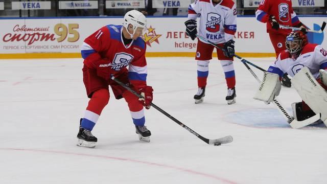 Russia's President Vladimir Putin attends a Night Hockey League match in Sochi