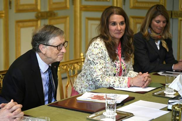 FILE PHOTO: Microsoft founder and billionaire philanthropist Bill Gates and his wife Melinda Gates attend a meeting with French President at the Elysee Palace in Paris