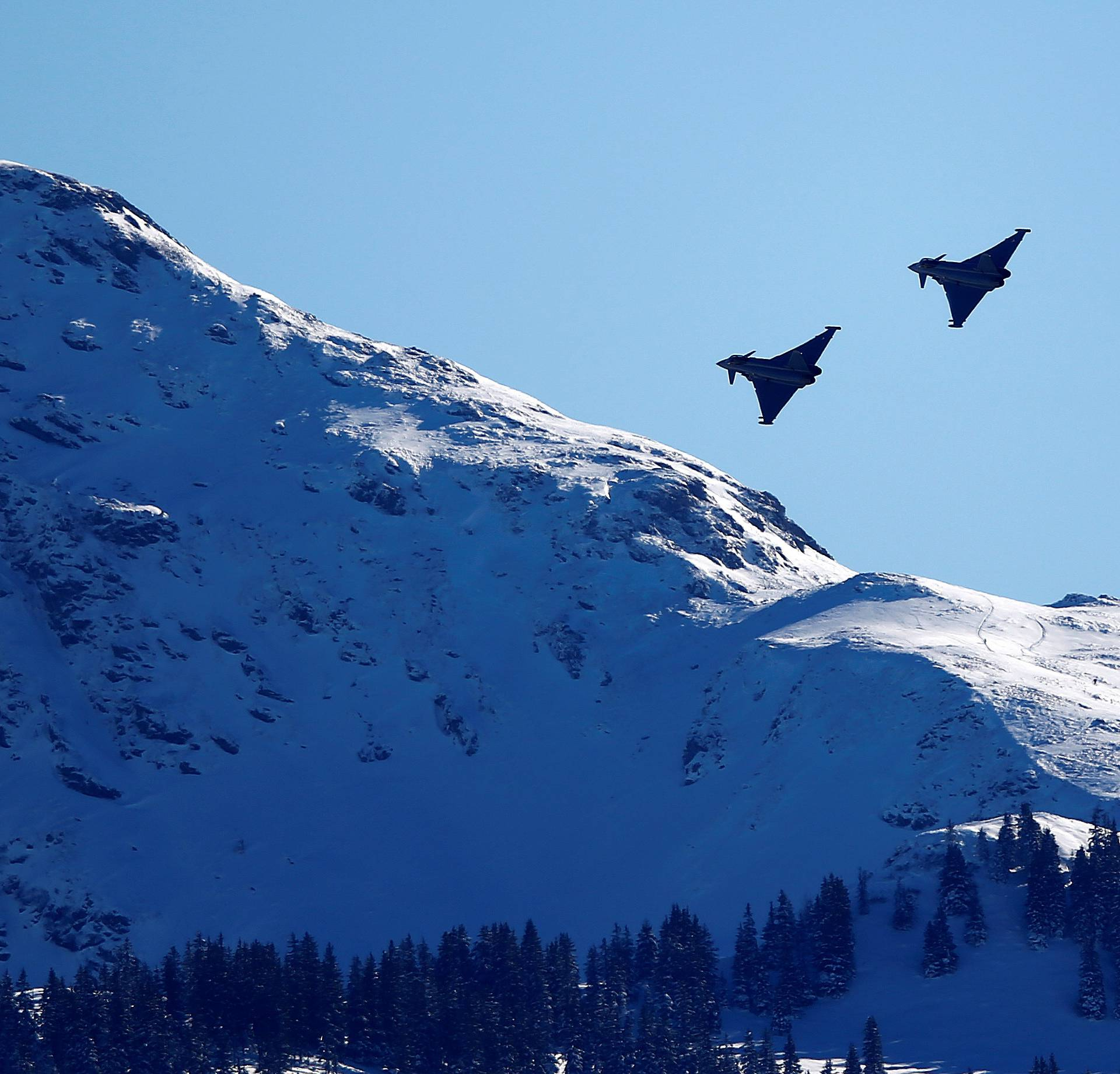 FILE PHOTO: Two Eurofighter Typhoon aircraft fly over the Streif course during an aerial exhibition before the start of the men's Alpine Skiing World Cup Super G race in Kitzbuehel