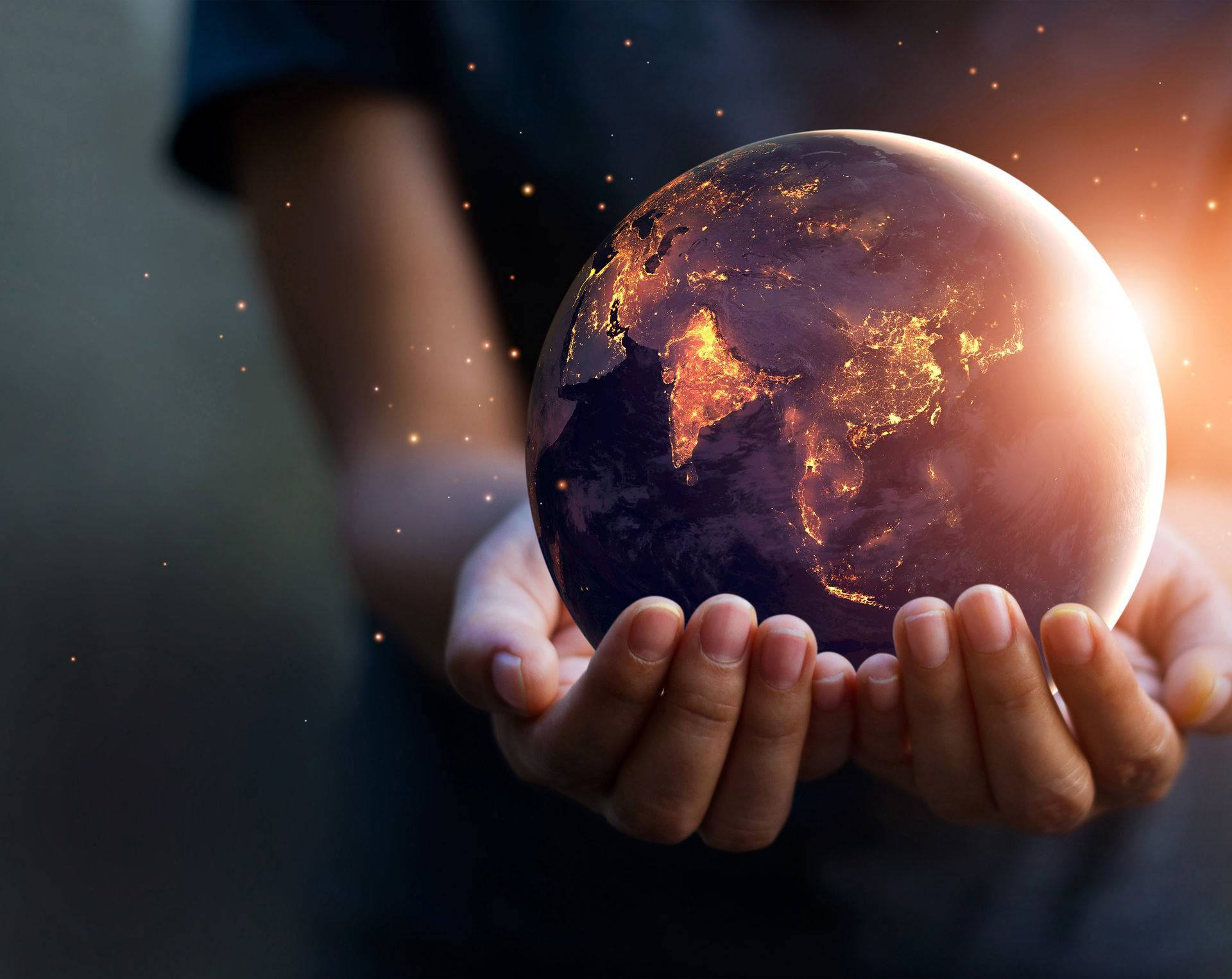 Earth at night was holding in human hands. Earth day. Energy sav