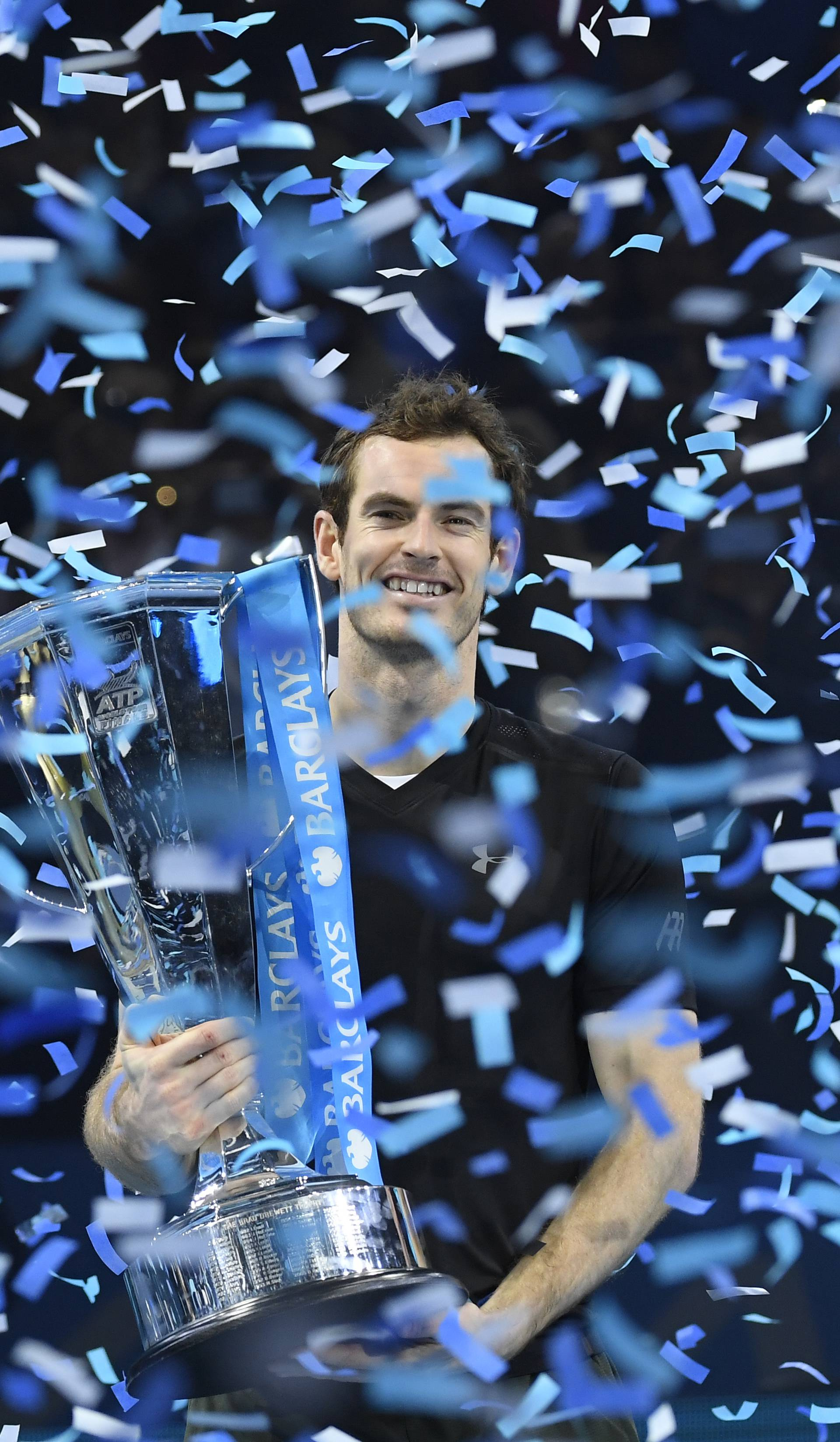 Great Britain's Andy Murray celebrates winning the final against Serbia's Novak Djokovic with the ATP World Tour Finals trophy