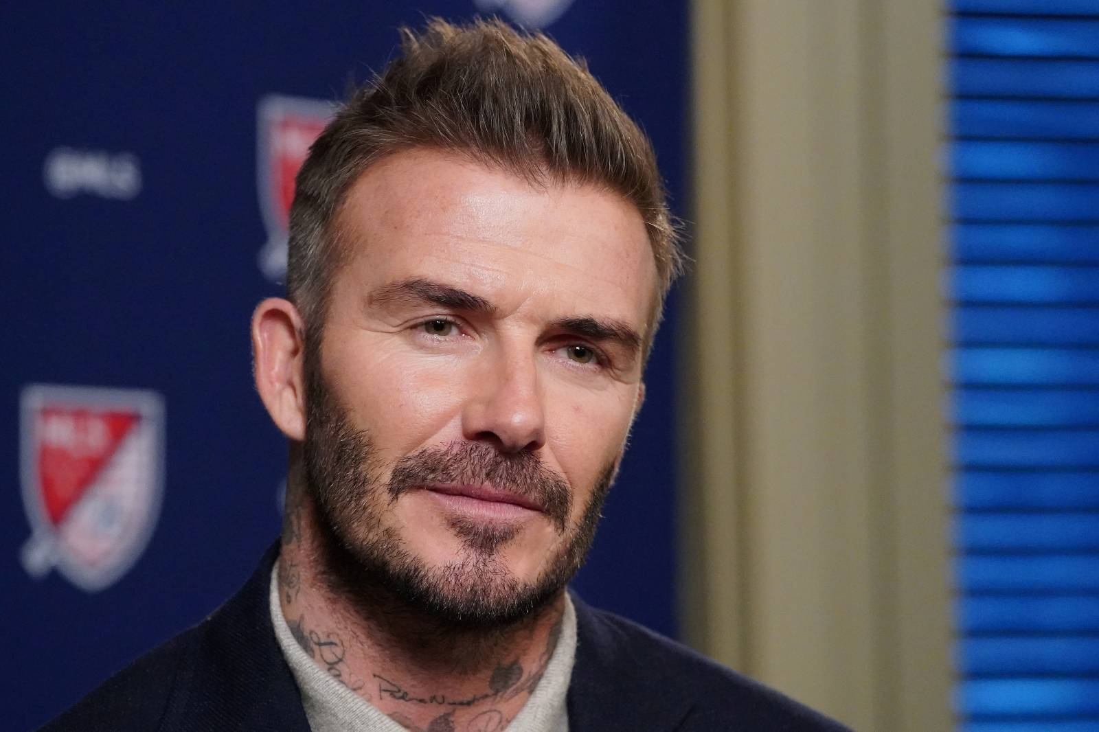 FILE PHOTO: Former soccer player and MLS team owner David Beckham speaks during an interview in the Manhattan borough of New York City