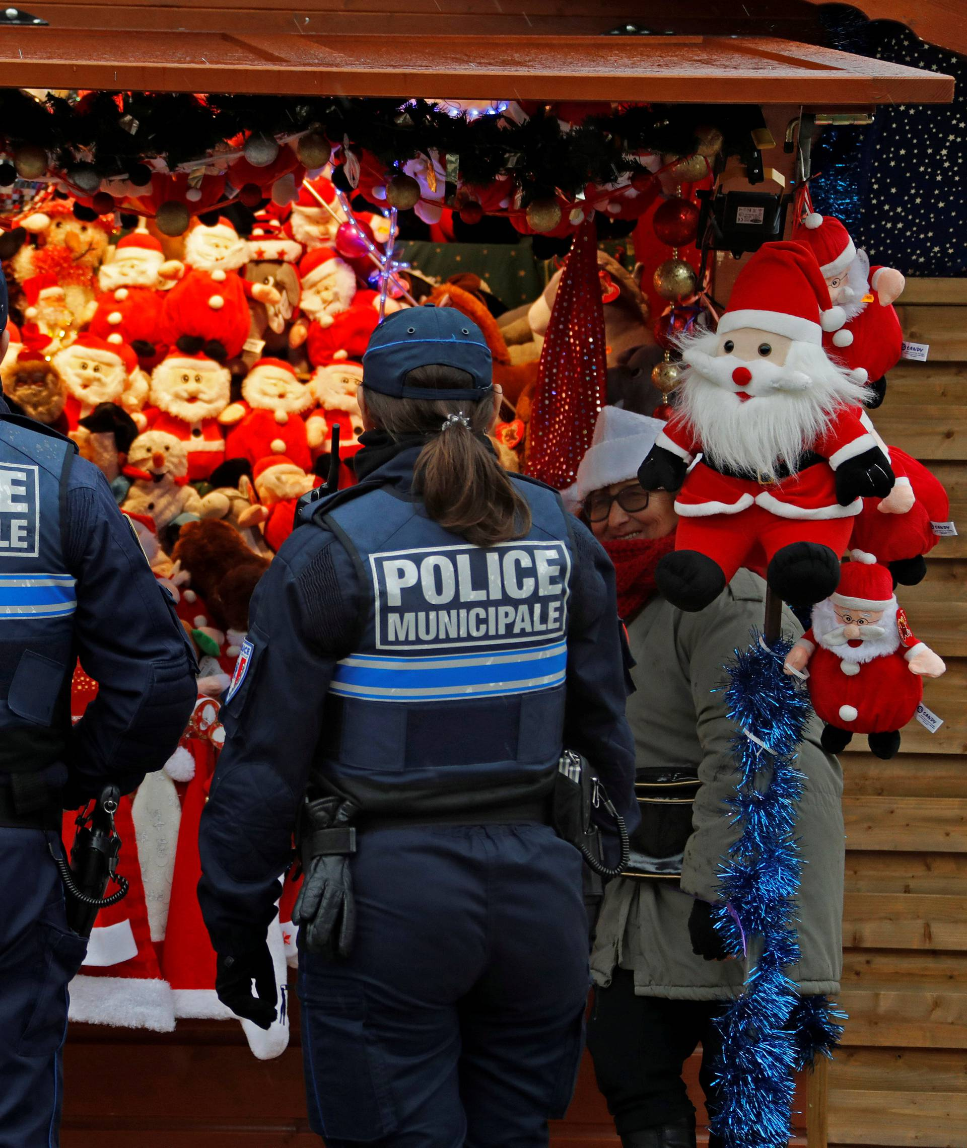 French municipal police officers patrol in the traditional Christmas market as emergency security measures continue during the Christmas holiday season in Nice