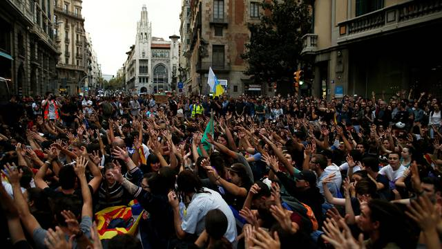 Demonstrators gather during a protest against Spanish National Police officers in Barcelona