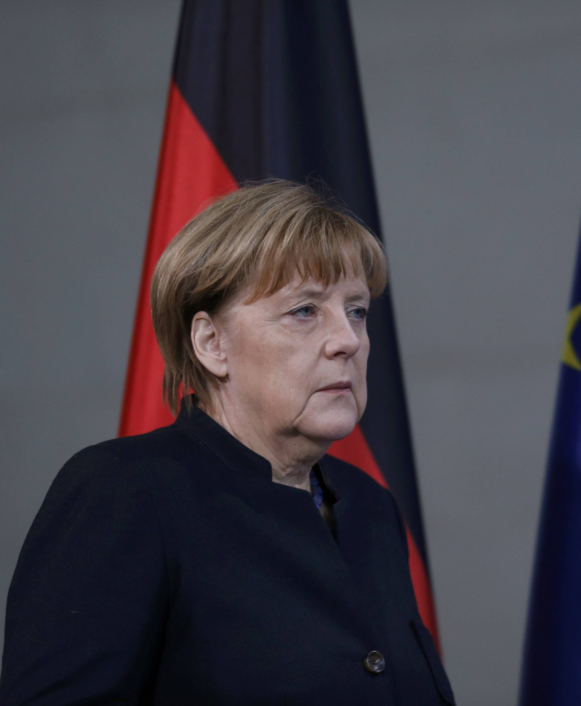 German Chancellor Angela Merkel arrives for a news conference in Berlin