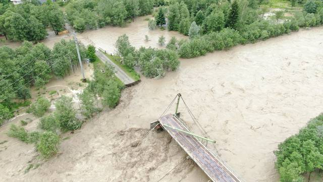 An aerial view shows destroyed bridge over the Chornyi Cheremosh river near the town of Verkhovyna in Ivano-Frankivsk region