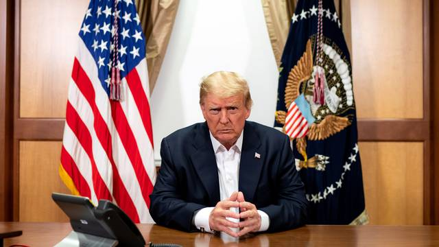U.S. President Trump participates in a phone call with Vice President Pence, Secretary of State Pompeo, and Chairman of the Joint Chiefs of Staff Gen. Milley in his conference room at at Walter Reed National Military Medical Center