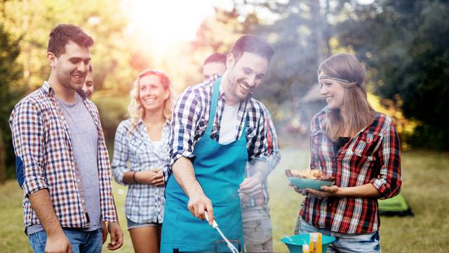 Friends,Camping,And,Having,A,Barbecue,In,Nature