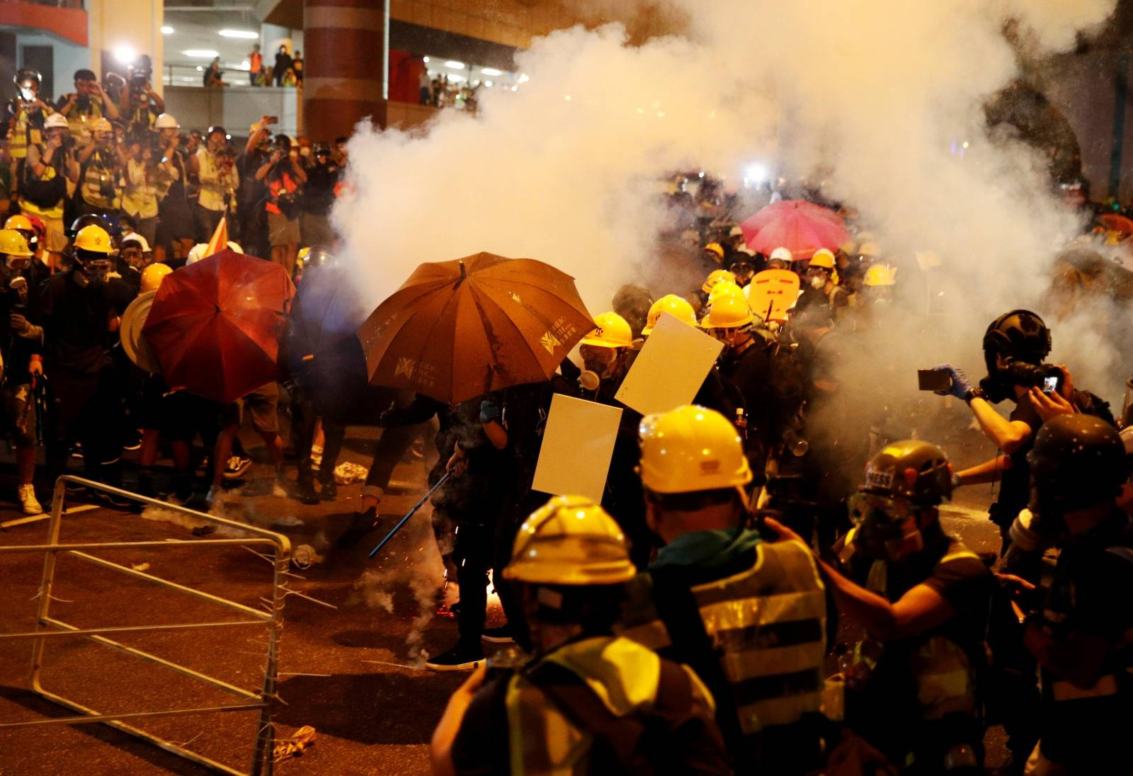 Anti-extradition demonstrators are seen a barricade, after a march to call for democratic reforms in Hong Kong