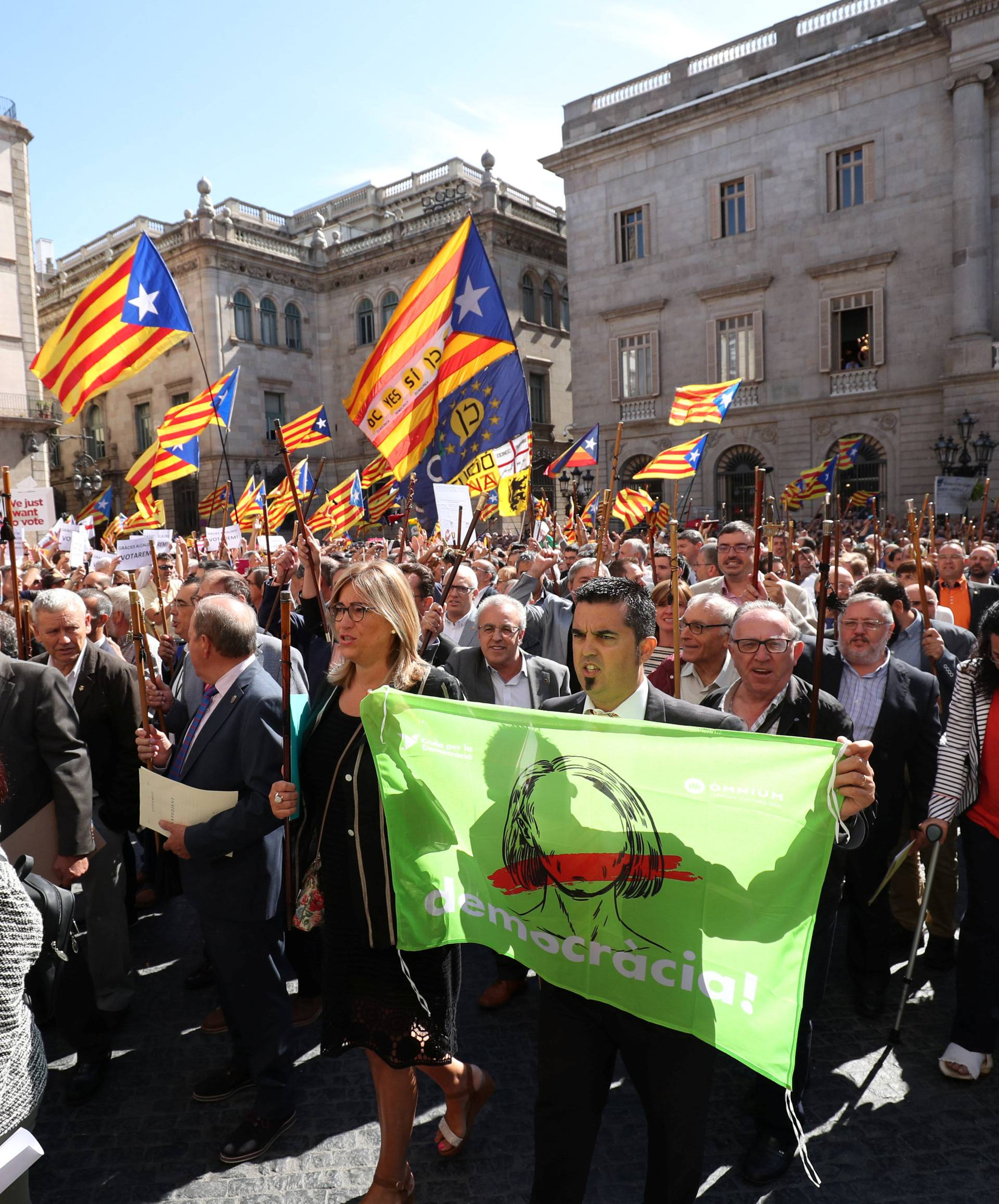 Mayors of towns of Catalonia that support the Referendum of 1-O arrive at Palau de la Generalitat in Barcelona