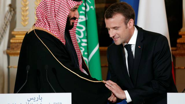French President Emmanuel Macron and Saudi Arabia's Crown Prince Mohammed bin Salman attend a press conference at the Elysee Palace in Paris