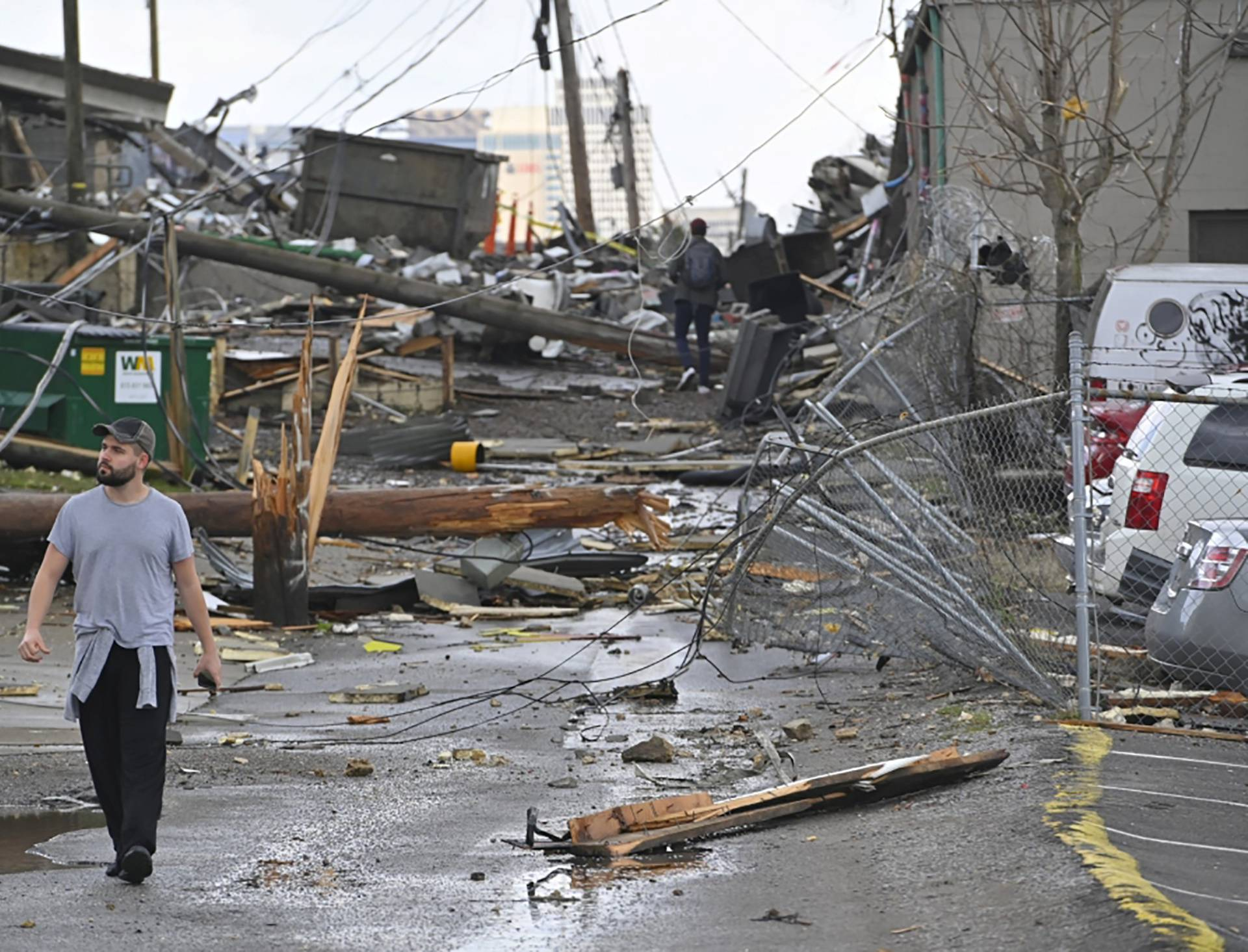 A man views damage in an alley behind Woodland Street after a tornado touched down in Nashville
