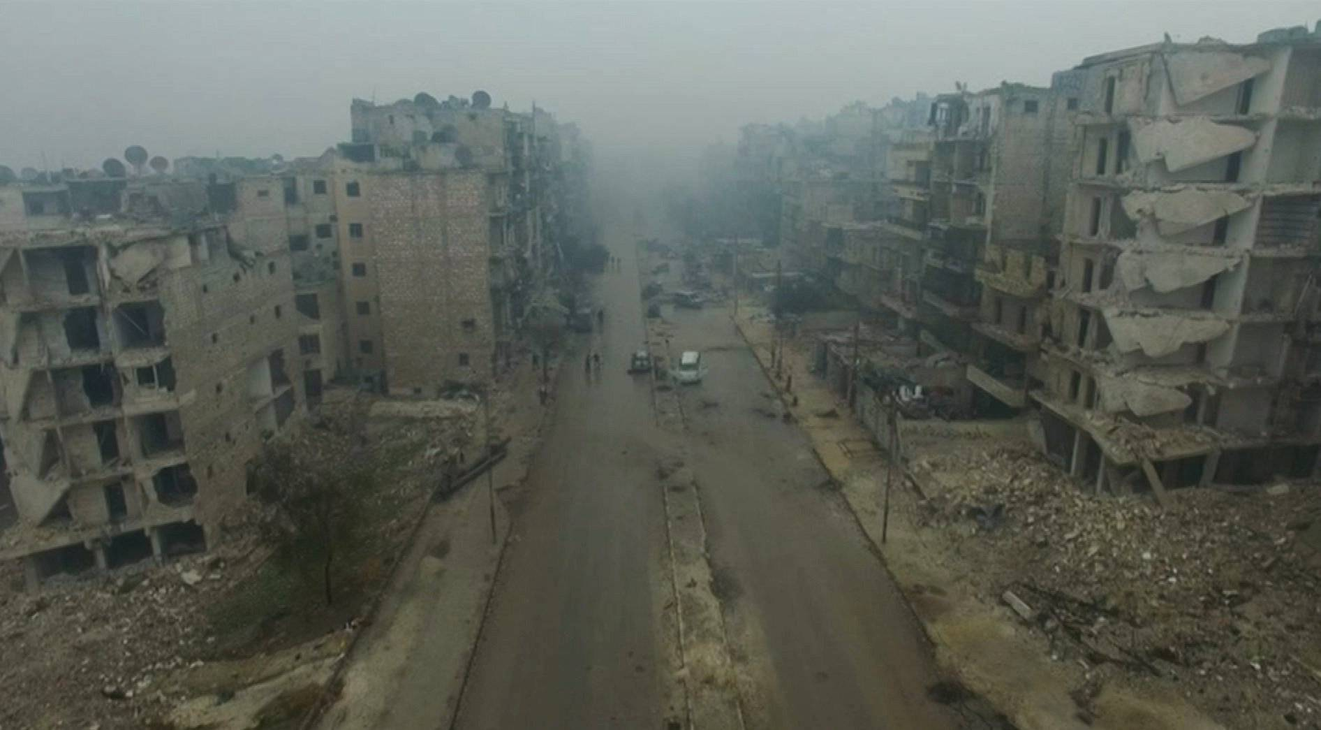 A still image from video taken December 13, 2016 of a general view of bomb damaged eastern Aleppo, Syria in the rain