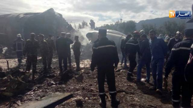 An Algerian military plane is seen after crashing near an airport outside the capital Algiers