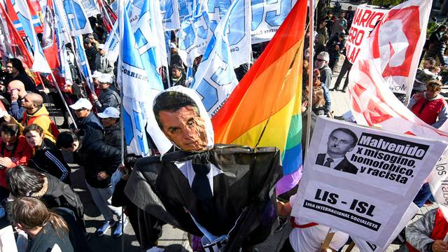 Demonstrators hold a puppet depicting Brazil's President, Jair Bolsonaro, during a protest outside the 54th Summit of Heads of State of Mercosur and Associated States, in Santa Fe
