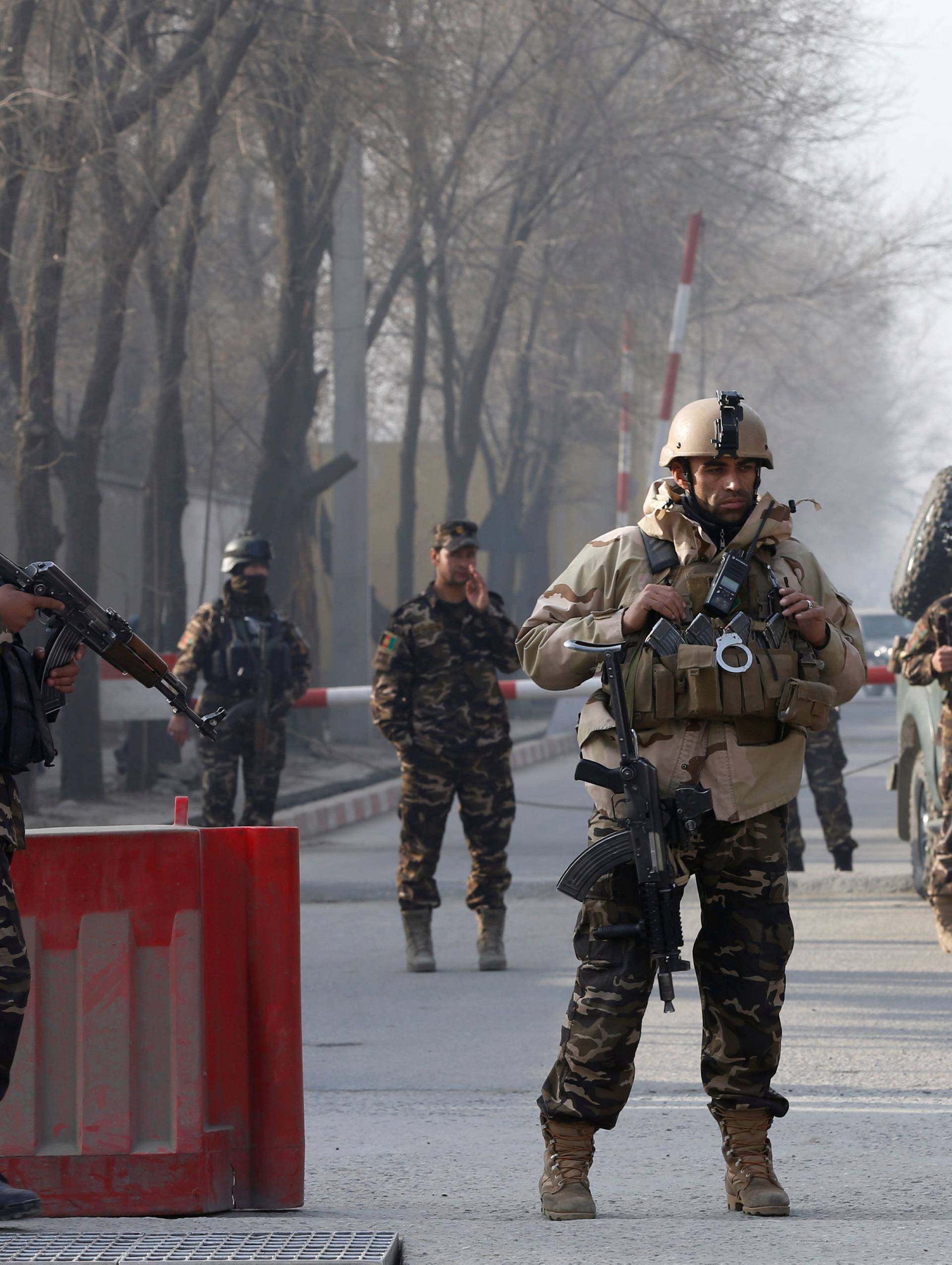 Afghan security forces keep watch at a check point close to a compound of Afghanistan's national intelligence agency in Kabul, Afghanistan