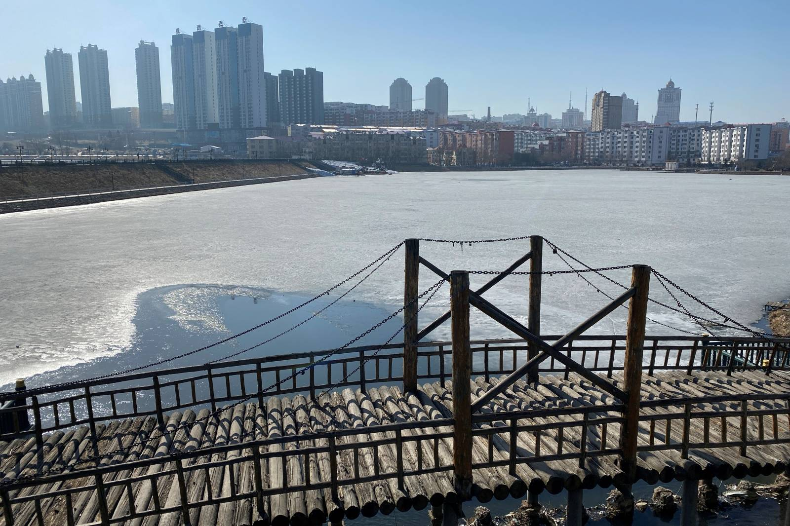 Residential buildings are seen near a river in Suifenhe, a city of Heilongjiang province on the border with Russia, as the spread of the novel coronavirus disease (COVID-19) continues in the country
