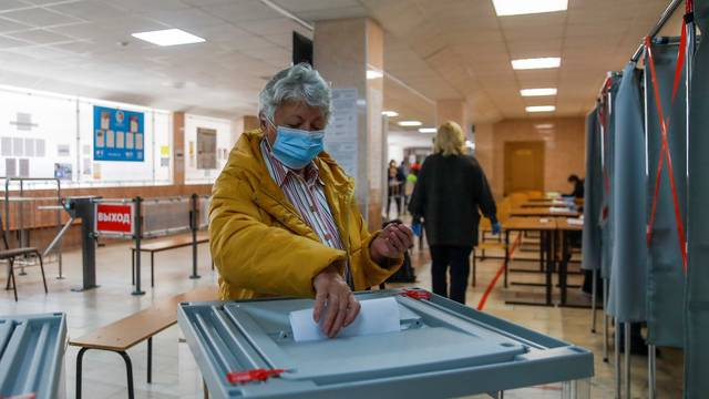 Woman casts a ballot during municipal elections in Tomsk