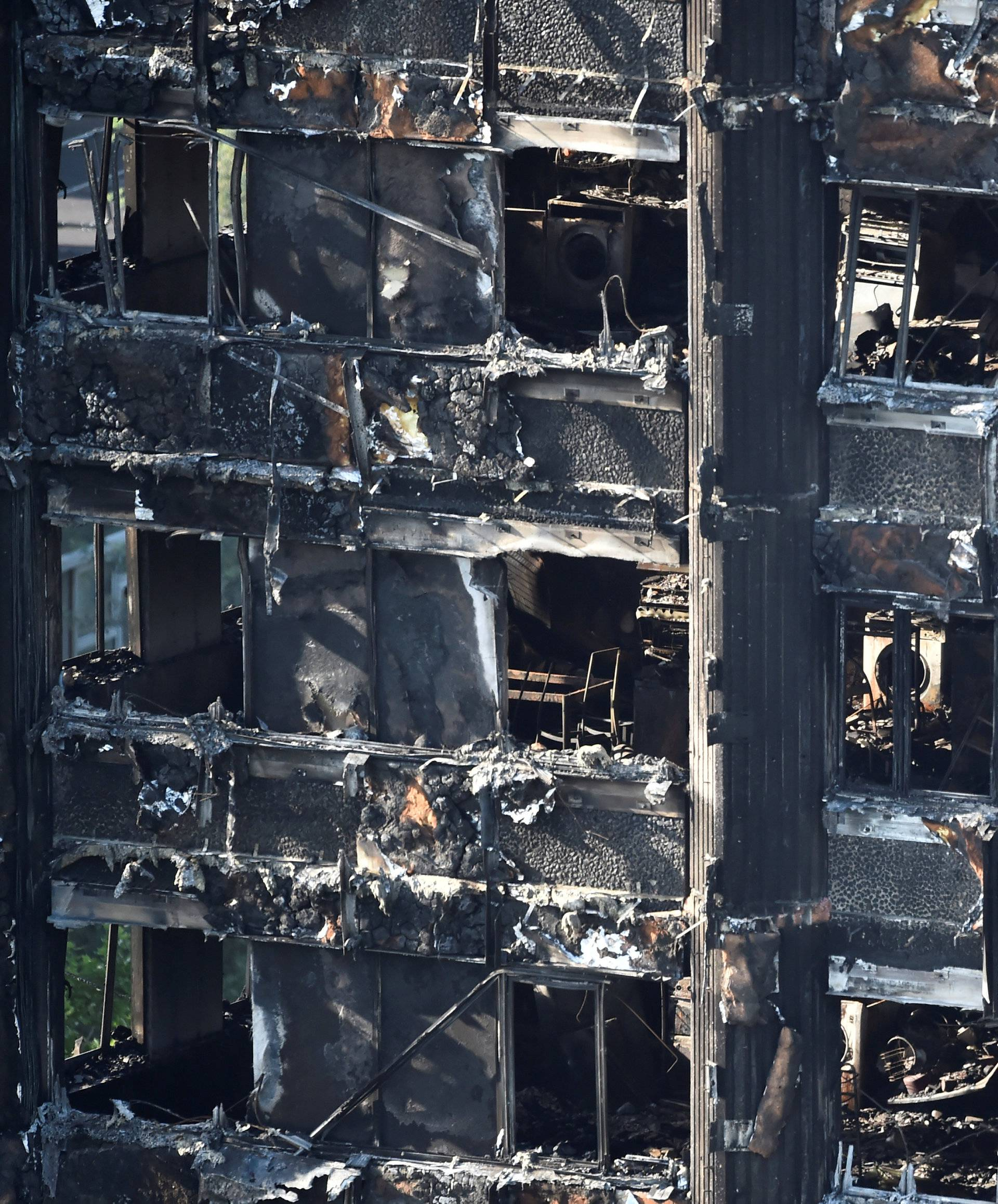 Extensive damage is seen to the Grenfell Tower block which was destroyed in a disastrous fire, in north Kensington, West London