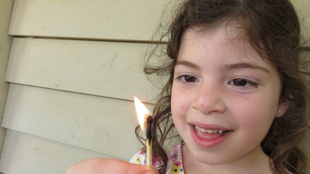 Child Playing With Fire