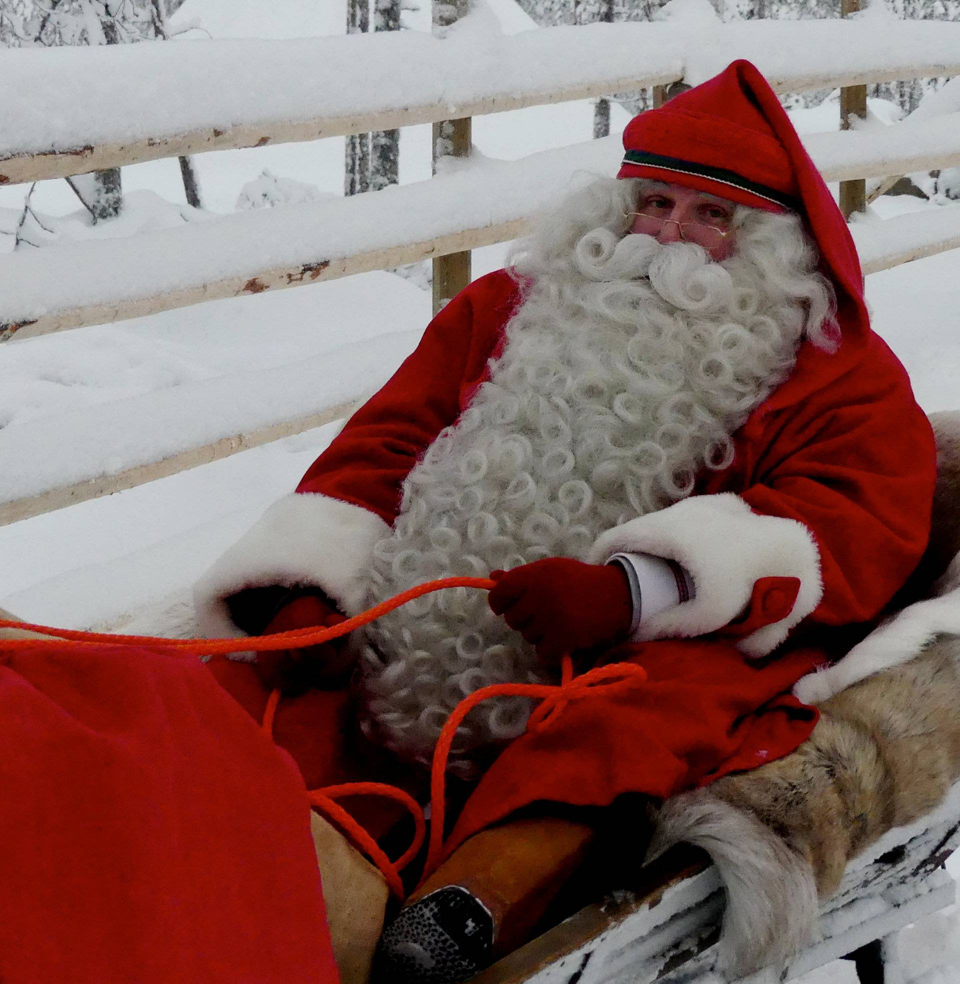 A man dressed as Santa Claus rides his sleigh near the Santa Claus Office located on the Arctic Circle near Rovaniemi