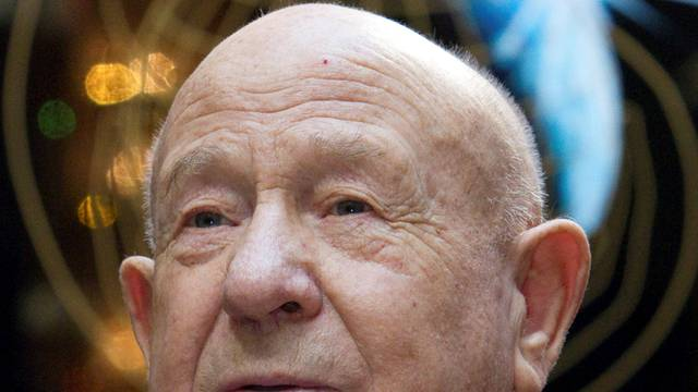 FILE PHOTO: Leonov, the first man to conduct a space walk in 1965, attends a photo exhibition in Moscow