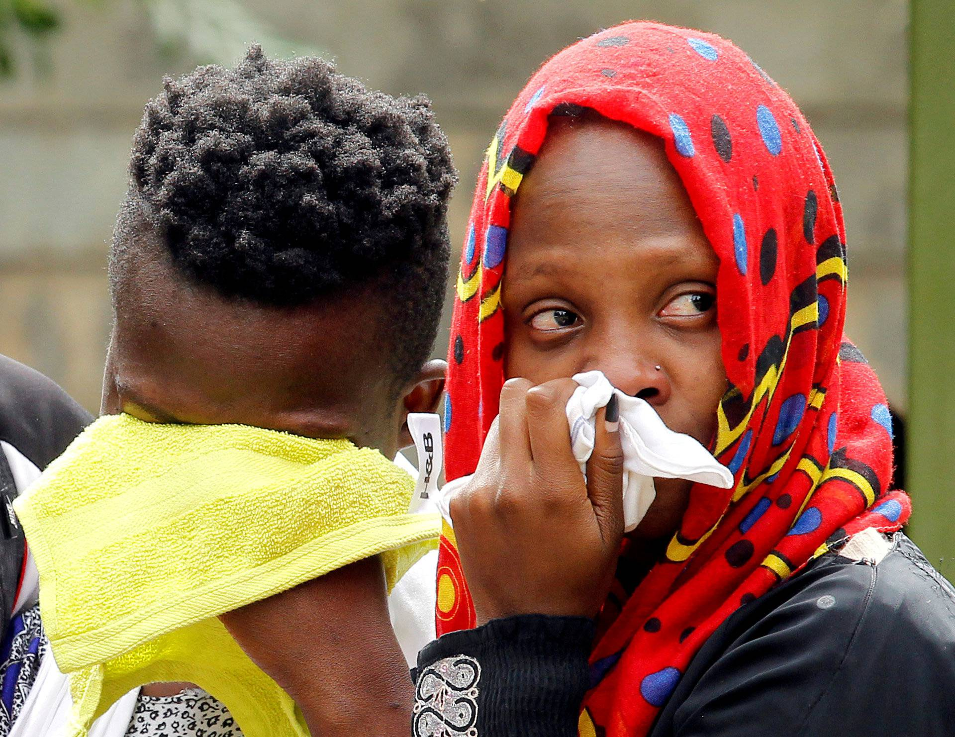 Relatives of a person, who was killed in an attack on an upscale hotel compound, grieve in Nairobi