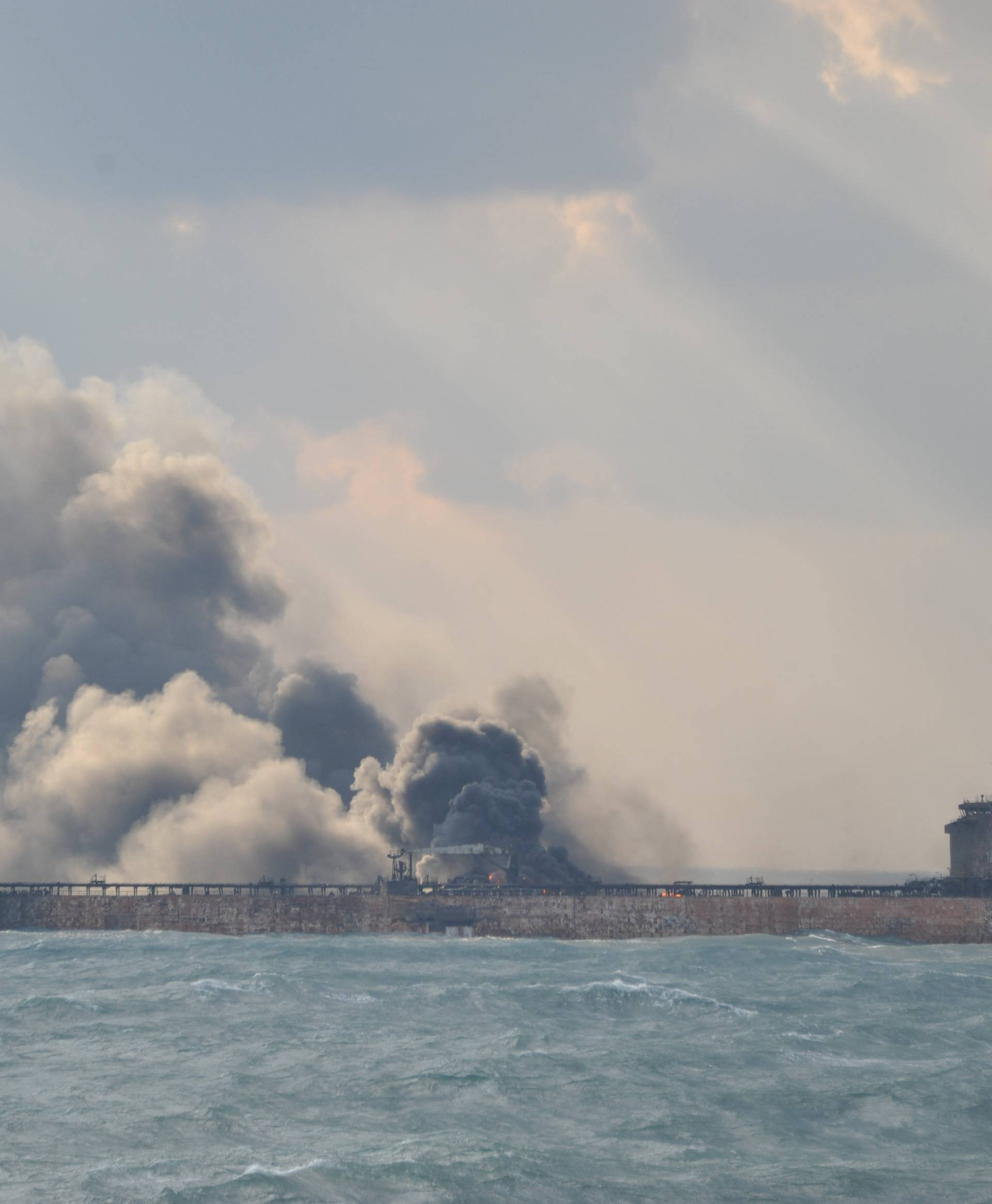 Smoke is seen from the Sanchi tanker which went ablaze after a collision with a Chinese freight ship in the East China Sea