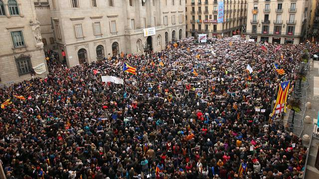 Protesters gather in Sant Jaume square at a demonstration during a partial regional strike in Barcelona