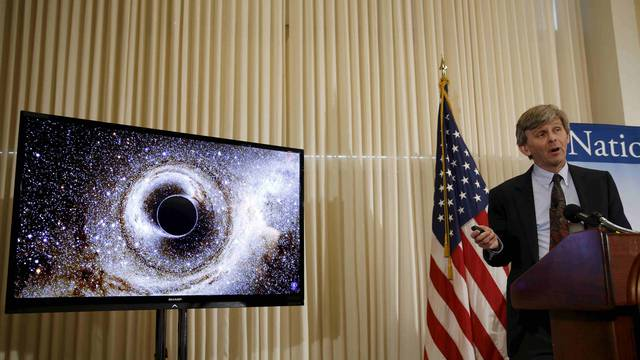 Dr. David Reitze shows the merging of two black holes at a news conference to discuss the detection of gravitational waves in Washington