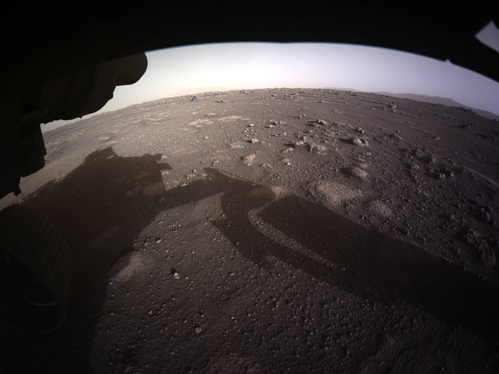 The first high-resolution, color image to be sent back by the Hazard Cameras (Hazcams) on the underside of NASA's Perseverance Mars rover