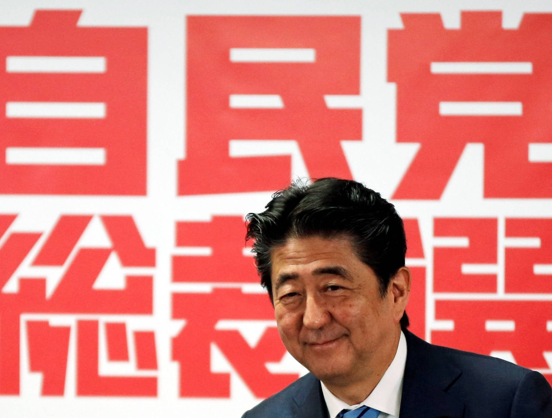 Japan's Prime Minister and ruling LDP leader Shinzo Abe attends a joint news conference for the party leader election at their headquarters in Tokyo