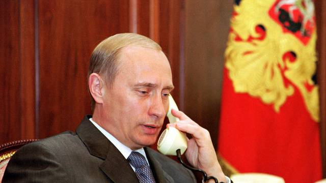 FILE PHOTO: Russian President Vladimir Putin speaks on the phone in his Kremlin office in Moscow